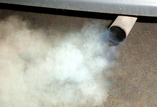 Carbon dioxide coming out of a car exhaust